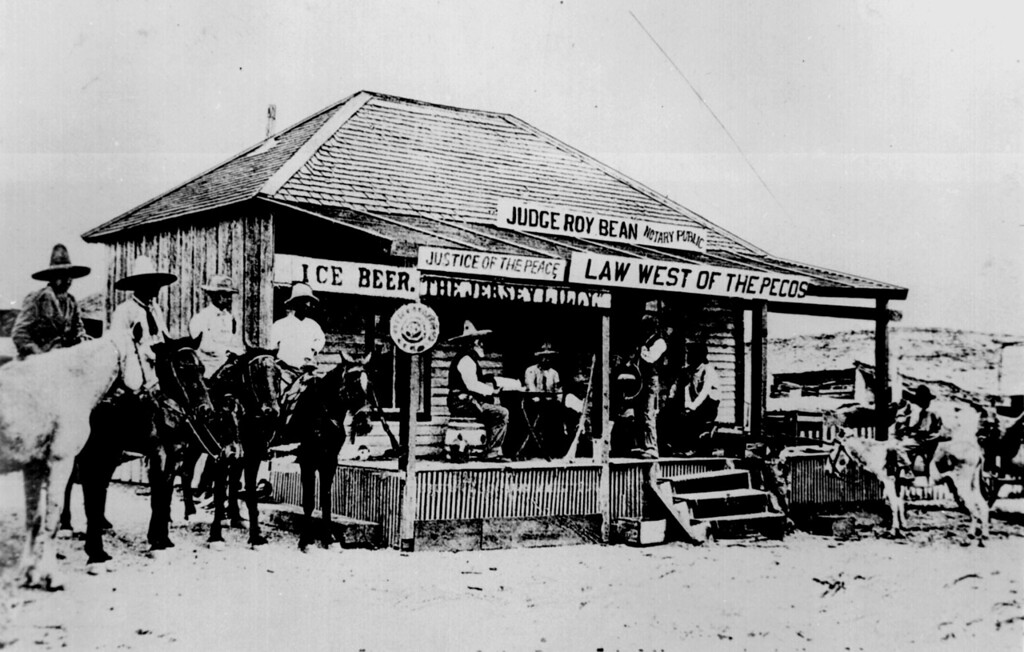 """Judge Roy Bean, the `Law West of the Pecos,' holding court at the old town of Langtry, Texas in 1900, trying a horse thief. This building was courthouse and saloon. No other peace officers in the locality at that time."""""""